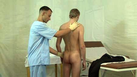Young boy take enema procedure on medical examination